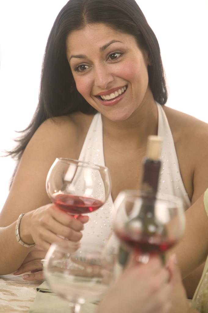Woman Enjoying Glass of Wine with Friends January 30, 2004